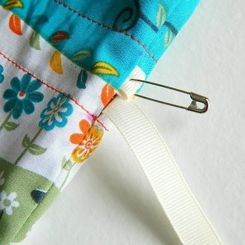 use_a_safety_pin_to_thread_the_ribbon